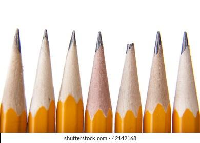 7 pencils, one being different, broken.