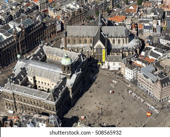 7 September 2016, Amsterdam. Aerial view of the Dam square with the Royal Palace, the Nieuwe Kerk and the Kalverstraat on a sunny day.