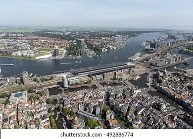 7 September 2016, Amsterdam, Holland. Aerial view of the Central Train Station CENTRAAL STATION. On the clear horizon Amsterdam North. At the other side of river IJ the A'DAM Tower.