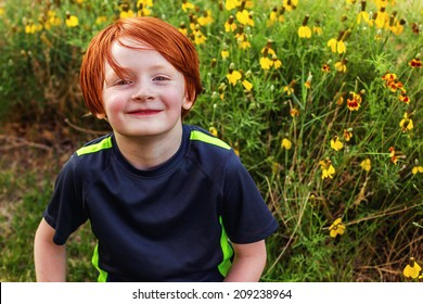 7 year old boy playing outside in a grassy field -- image taken in Reno, Nevada, USA