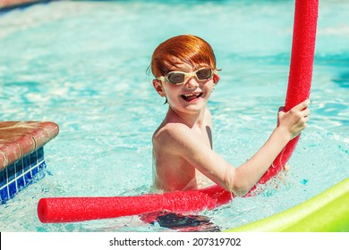 7 year old boy swimming in a pool on a hot summer day -- image taken outdoors in Reno, Nevada, USA