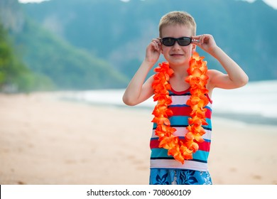 7 year old boy in traditional Hawaiian Lei on the beach