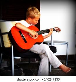 7 year old playing guitar
