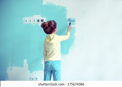 7 years old girl painting the wall at home, Instagram style toning