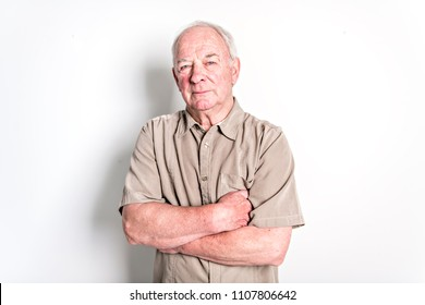 70 year old senior man standing isolated on white background