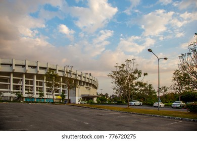 The 700th aniversary (name) grand stadium next to the car park and trees  in the late afternoon with the cloudy sky in Chiang Mai province , Thailand. This picture is taken 16 December 2017 5:30 pm.