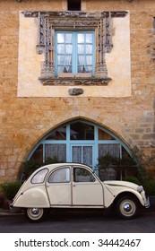 70s, old vintage car in front of old house, france