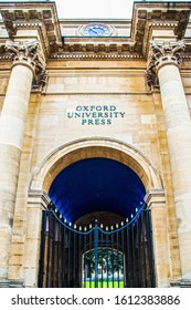 7-27-2019 Oxford UK View of an entrance to Oxford University Press with pillars and and a courtyard seen through an iron gate