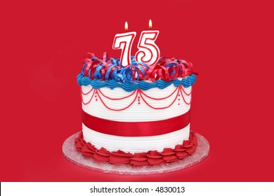 75th cake with numeral candles, on vibrant red background.