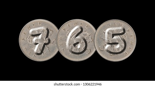 765 – Coins on black background