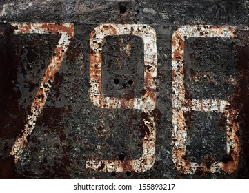 796 number on rusty plate