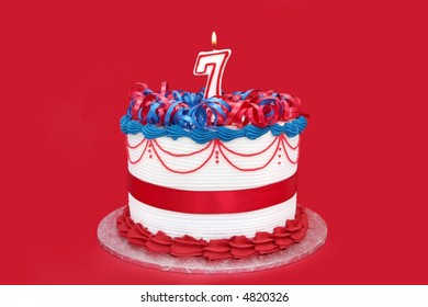7th Cake With Numeral Candle On Vibrant Red Background Birthday Anniversary Etc