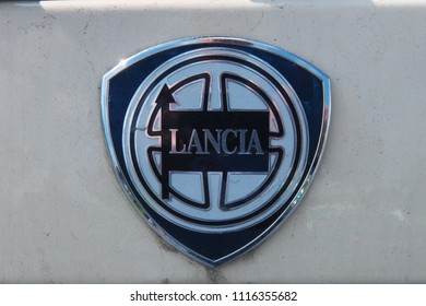 7th June 2018- The enamel name badge on a Lancia Ypsilon car in a carpark at Haverfordwest, Pembrokeshire, Wales, UK.