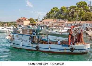 8. 28. 2012. Vrsar. Croatia. Two sailors clean the fish caught. Fishing in the Adriatic sea