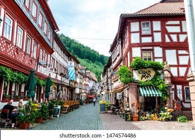8 August 2019: Street with colorful half-timbered houses, peaple, restaurants, shops nearby marketplace in  old german town Miltenberg am Main river. Odenwald, Bavaria, Germany