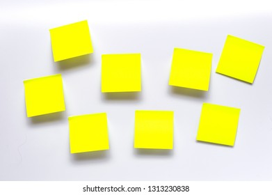 8 blank yellow notes on white background