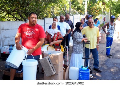 8 February 2018 - Cape Town, South Africa : Capetonians queue for water