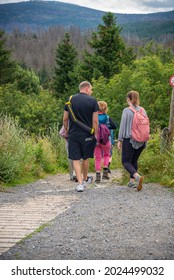 8. july-2021, Harz, Germany. Father and mother and two children, with backpack ready for a hiking trip in the northern German mountains. Close to Goslar which is one of the highest places in the natio