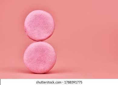 8 March macaroons. International Womens Day celebrate concept, copy space. Pastel pink background. Colorful small cookie from ground almonds and coconut. Symbol of the annual 8 March holiday