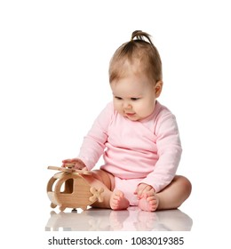 3424ef71a528 Delighted Baby Girl Sits Sideways Holding Stock Photo (Edit Now ...
