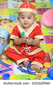 8 month old baby wearing a red dress for the Chinese New Year.