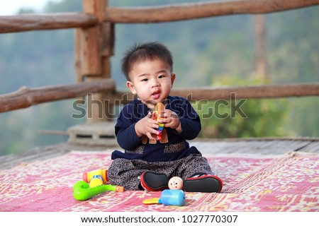 Best Baby Toys For 8 Months Old : 8 month old thai boy dressed stock photo edit now 1027770307