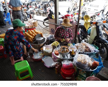 8 November 2017 , Customers waiting for female chef cooking original Cambodian food in the central market at Phnom Penh, Combodia.