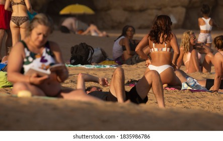 8 October 2020, A summer beach day with some strangers in Lagos, Algarve, Portugal.