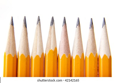 8 pencils lined up side beside each other