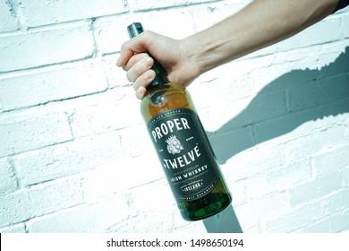 8 September 2019, United Kingdom, Exeter: Bottle of Proper Twelve whisky in hand. Conor McGregor whisky
