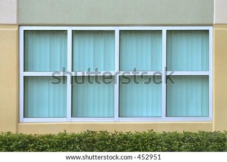 tinted glass window reflective symmetrical tinted glass windows with hedge symmetrical tinted glass windows hedge stock photo edit now