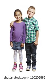 8 year old boy and girl standing together smiling on white background