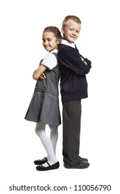 8 year old school boy and girl stood back to back on white background