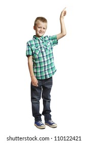 8 year old school boy pointing up on white background