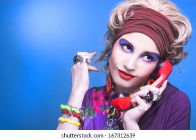 80-ears style. Young woman with bright visage with vintage telephone.