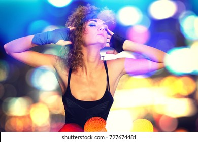 80's Fashion woman over bokeh background