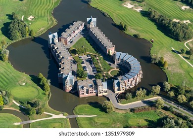 8-10-2018, Den Bosch, Holland. Aerial view of new modern residential area with appartments in a castle housing comlex. It is retro in the shape of a fortress. This is Holterveste in Engelen area.