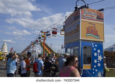 8-27-17 Syracuse, NY: People stand in line for ride tickets at the Great New York State Fair.
