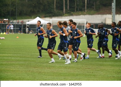 8-3-06 Chelsea Football Club, world famous soccer team, practicing at UCLA, in Los Angeles.  Warming up with a jog with Captain John Terry in the lead looking at camera