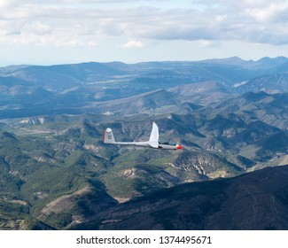 8-4-2019, Aubenasson, France. Aerial view of glider Duo Discus PH-1198 in the French Alps. This sailplane is owned by gliding club EZZC. The plane is just passing a mountain ridge in the drome valley.