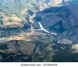 8-4-2019, Saillans, France. Aerial view of glider Duo Discus PH-1198 in the French Alps. This sailplane is owned by gliding club EZZC. The plane is just passing a small village in the drome valley.