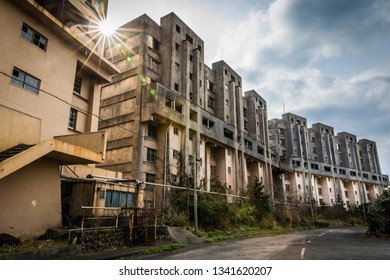 The 8-Floor Apartment Blocks, the largest housing complex on the coal mining island of Ikeshima in Japan—now abandoned and decaying after the mine's closure in 2001.