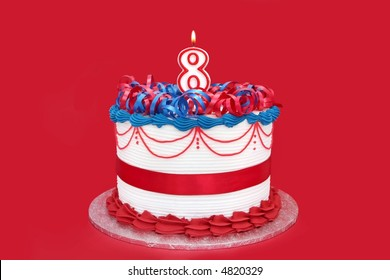 8th cake, with numeral candle, on vibrant red background.  Birthday, anniversary, etc.