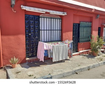 8th October 2019, Sitio de Calahonda, Mijas, Costa Del Sol, Spain. Traditional Spanish home in Calahonda town with cloths hanging outside on a clothes horse rail to dry in the sun.