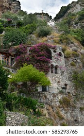 8th September 2016 - Positano, Italy A bougainvillea clad stone house built into the hillside of the steep hills around Positano.