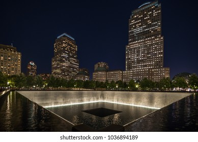9 11 memorial shot at night with building in the back