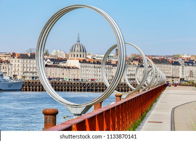 9 April 2015: Nantes,  Loire Atlantique, France - The Rings by Daniel Buren and Patrick Bouchain, the ship is the French destroyer Maille Breze, decommissioned in 1988 when she became a museum ship.