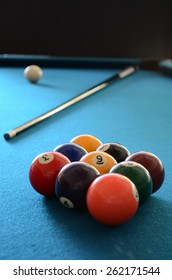 9 ball set-up on blue felt table