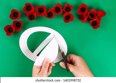 9 Diy wreath red poppy Anzac Day, Remembrance, Remember, Memorial day made of cardboard egg trays on green background. Gift idea, decor. Step by step. Top view. Process kid children craft. Workshop.