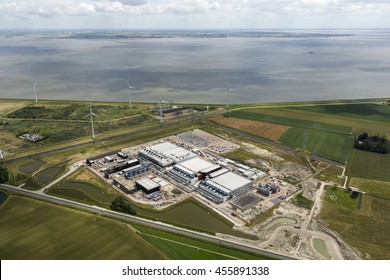 9 July 2016, Eemshaven, Netherlands. The new datacenter of Google which is being built near Delfzijl in the province of Groningen. On the clear horizon some cumulus clouds, the Waddenzee and Germany.